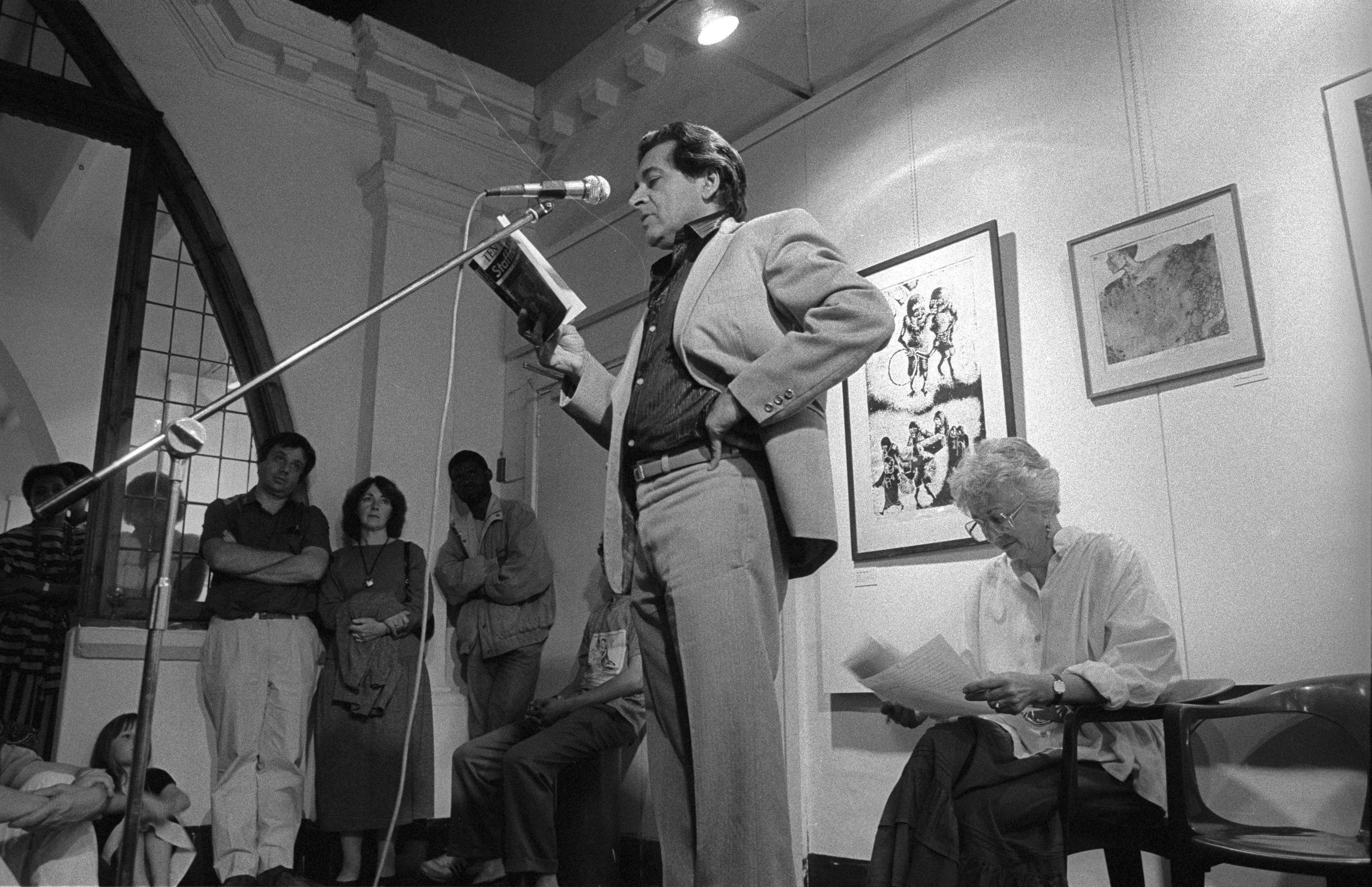 Writer Ahmed Essop speaking at Market Photo Gallery - 10 years of Staffrider exhibition and book launch 1988. © Omar Badsha