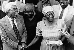 October. From left; Walter Sisulu, Archbishop Desmond Tutu and Albertina Sisulu celebrate Walters release from prison. © unknown